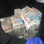 Half a million in cash seized by police.